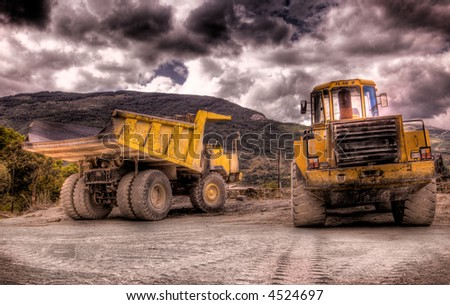 Two construction vehicles