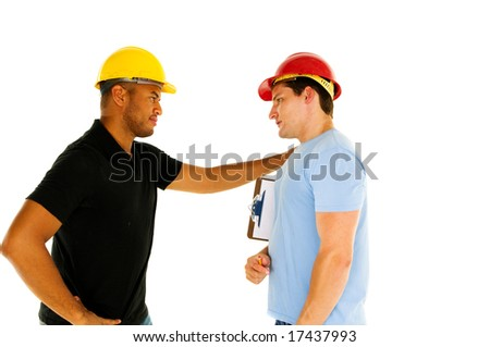 two construction workers have serious conversation - stock photo