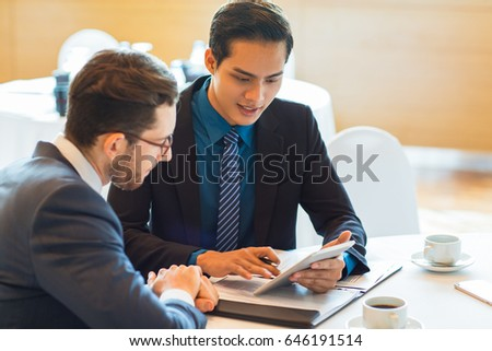 Two Content Business Partners Discussing Issue #646191514