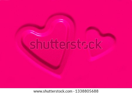 Two convex contours of hearts on a pink metallic background #1338805688