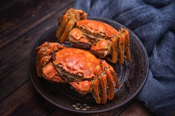 Two cooked hairy crabs on the table.
