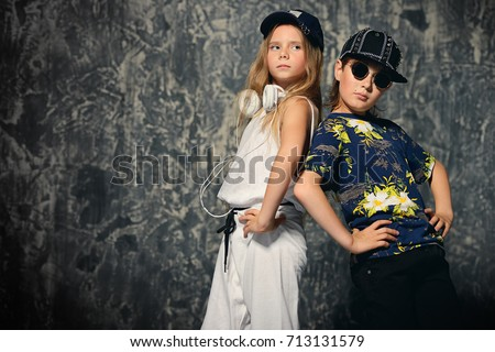 62bb22650 Two cool modern kids posing together in hip-hop style clothes. Children's  fashion.