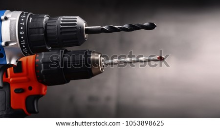 Two cordless drills with drill bits working also as screw guns.