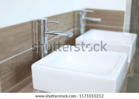 Two Countertop washbasins in a modern bathroom with depth of field - Shutterstock ID 1171010212