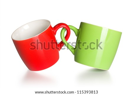 two coupled coffee mugs on white background