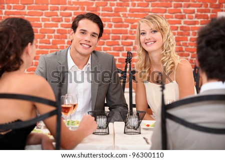 two couples in a restaurant