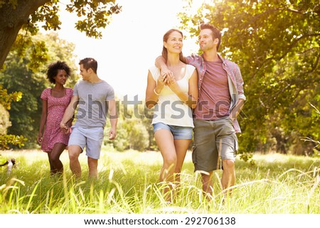 Two couples walking together in the countryside #292706138
