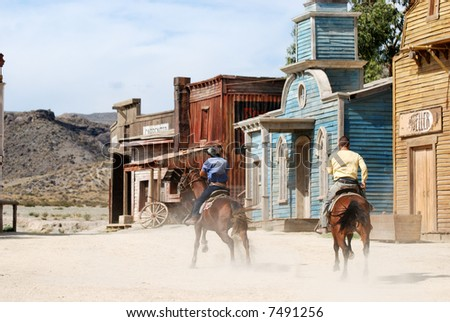 Two cowboys in a traditional American western town