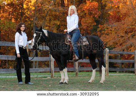 Two Cowgirls with Horse