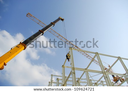 Two cranes at a construction site