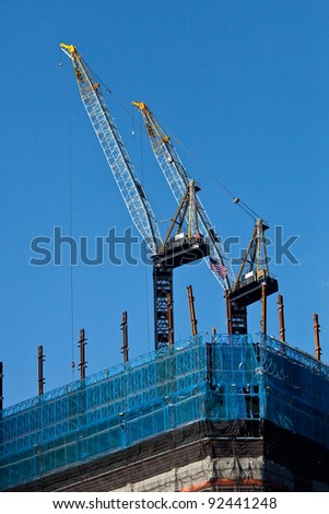two cranes in the construction of building