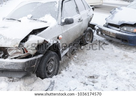 Two crashed cars in accident on winter road with snow #1036174570