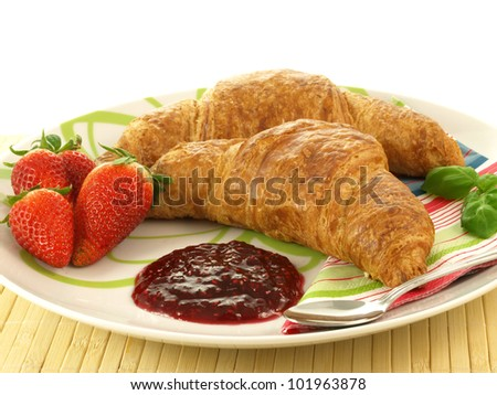 Two crispy croissants with strawberry and jam