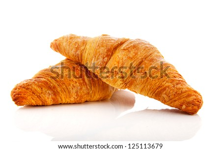 Two croissants isolated over white background