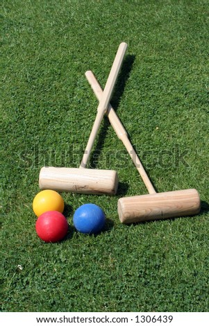 Two croquet mallets and three balls