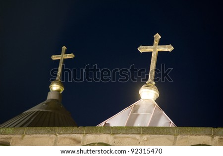 Two crosses on the roof of a church in the evening light in the Netherlands - stock photo