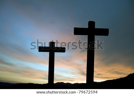 Two crosses silhouette and the clouds at sunset