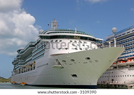 Two Cruise ships docked alongside each other in port