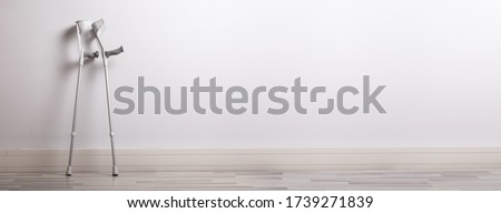 Two Crutches Leaning On Wall In Clinic Stock photo ©