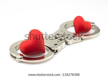 two cuffed hearts on white background