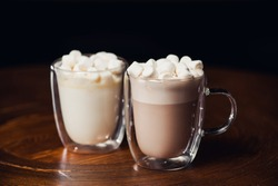 Two cup of hot cacao drink served with marshmallows