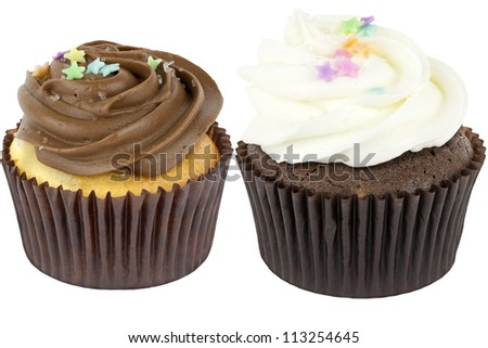 Two Cupcakes-One cupcake with yellow cake and chocolate icing and One cupcake with chocolate cake and white chocolate icing -- Both with sugar crystals and confetti star sprinkle - stock photo