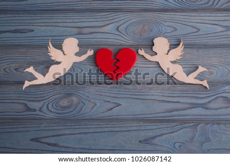 two cupids collect a broken heart made from the background of a tree texture. The holiday of lovers. Valentine's Day. wedding, renewal of otnasheny. space for text and design #1026087142