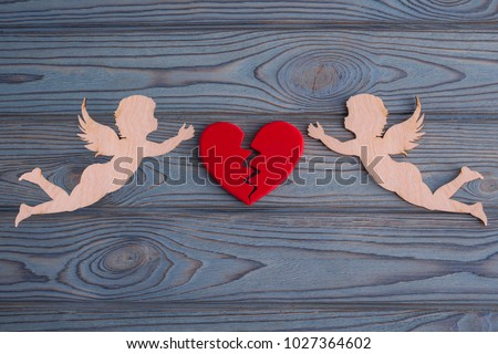 two cupids collect a broken heart made from the background of a tree texture. The holiday of lovers. Valentine's Day. wedding, renewal of otnasheny. space for text and design #1027364602
