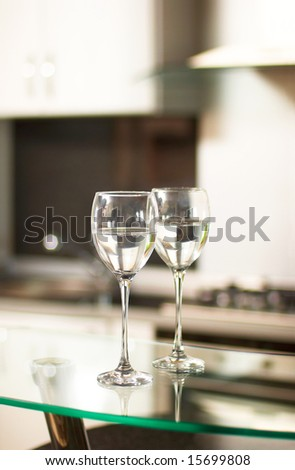 Two cups for wine in kitchen interior