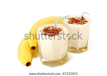 two cups of banana cocktail with bananas on white background