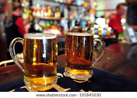 Two cups of beer in a pub in New Zealand. Concept photo of drinking beer and alcohol