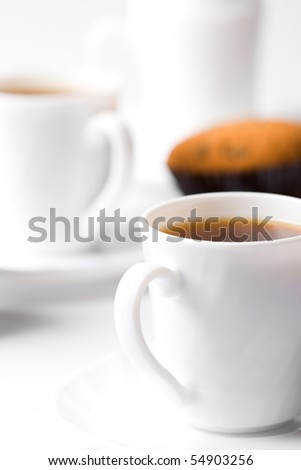 two cups of coffee and muffin closeup - stock photo
