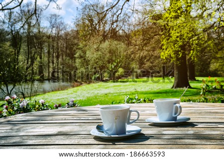 Two cups of coffee in outdoor setting