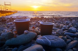two cups of coffee on the sea coast. beach. backgrounds for advertising and travel vouchers. For hikers, freelancers. sea and beach advertising. Rest for two, love, honeymoon.