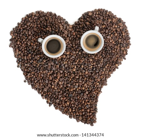 two cups of coffee over a heart made of coffee beans