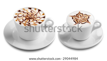 two cups of coffee with froth decoration