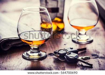 Two cups of cognac brandy or rum with car keys. #564700690