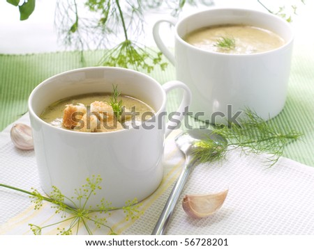 Two cups of creamy vegetable soup