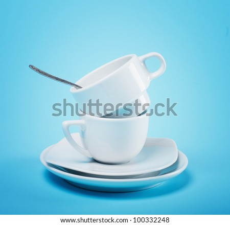 two cups on a blue background