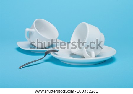 two cups on a blue background - stock photo