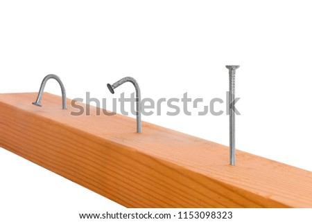 Two curved and one straight nail in a wooden bar. Isolated on white background. Endless focus, endless sharpness.   #1153098323