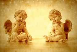 Two cute angels sitting in sepia tone