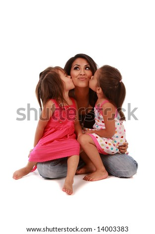 Two cute daughters kissing their mom on pure white background - stock photo
