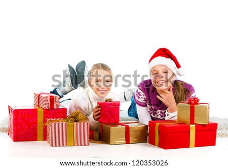 Two cute girls with a lot of presents over a white background