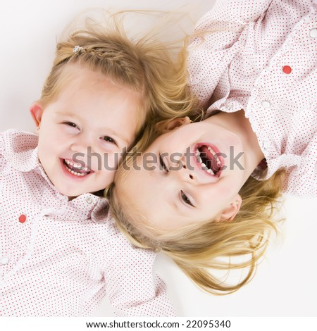 two cute twin sisters having fun