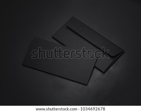 Two dark envelopes isolated on black background. 3d rendering