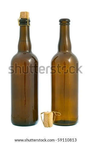 Two dark glass beer bottles and cork with golden wire. Isolated on white background