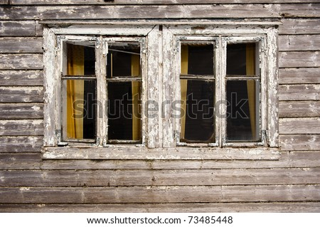 Two dark windows in old haunted house