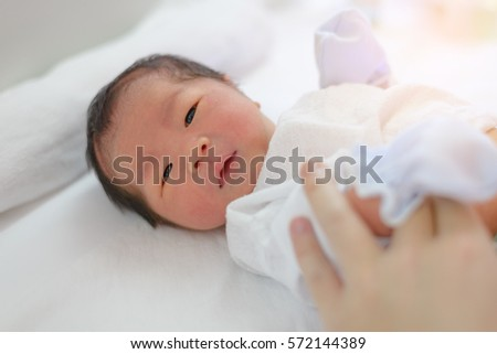 two day old asian baby boy in...