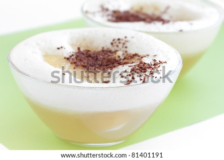 Two delicious desserts with pear and chocolate crumb in glass bowls isolated on white background